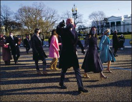 ?? DOUG MILLS — THE NEW YORK TIMES ?? President Joe Biden, first lady Jill Biden and family walk in front of the White House during the presidential escort, part of Inauguration Day ceremonies on Wednesday.