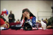 ?? JOHN LOCHER — THE ASSOCIATED PRESS ?? President Donald Trump supporter Loretta Oakes reacts while watching returns in favor of Democratic presidential candidate former Vice President Joe Biden, at a Republican election-night watch party, Tuesday, in Las Vegas.