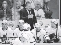 ?? MARK HUMPHREY/THE ASSOCIATED PRESS ?? Maple Leafs' head coach Peter Horachek talks to his players. The Leafs are trying to focus on the present while the future holds a major makeover and trades.