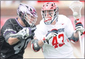 ?? SHABAN ATHUMAN/TIMES-DISPATCH ?? Richmond attack Brett Randall (43) carries the ball past High Point midfielder Joel Scerbo at Robins Stadium. The Spiders were forced to rally after a 7-1 deficit.