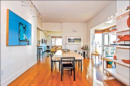?? Photog raphs by Caitlyn Barrick Planomatic ?? A LARGE WINDOW brings light into the dining area of this Westwood condo, which is listed at $3.495 million.