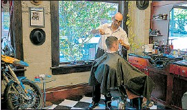 ?? — HANDOUT ?? Farzad Sakehi tends to a customer at his Barber Shop in Vancouver. He likes to keep a small but personal establishment.