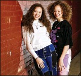 ?? NICK GRAHAM / STAFF ?? The Cunningham sisters, Macie, 15, left, and Marie, 13, have been singing on social media trying to spread a positive message and recently sent an audition video to the television show The Voice.