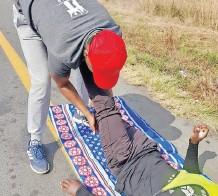??  ?? #Walk4access team member assists an injured participant during their walk.