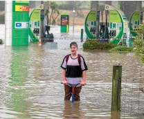 ?? PHOTO: MYTCHALL BRANSGROVE/STUFF ?? The rain and rising floodwater weren't enough to deter Cameron King from jumping on his scooter next to the state highway through Timaru yesterday.