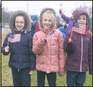 ??  ?? Children from Chesapeake Christian Academy show their patriotic pride. There was a parade like scene that kept everybody's spirits up.
