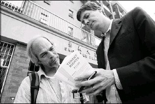 ?? RICHARD LAM/ VANCOUVER SUN ?? David Eby talks to Downtown Eastside resident Hendrik Beune while with the Pivot Legal Society.