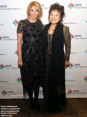 ??  ?? Susan DeMusis, left, and Dora Lau, were this year's honorees at the Project HUG Gala in New York City.