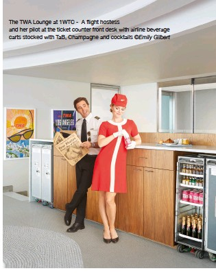 ?? ©Emily Gilbert ?? The TWA Lounge at 1WTC - A flight hostess and her pilot at the ticket counter front desk with airline beverage carts stocked with TAB, champagne and cocktails