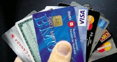 ?? RYAN REMIORZ/ THE CANADIAN PRESS ?? Statistics Canada says the percentage of Canadian families with debt was 71.1 per cent in 2012, up from 67.3 in 1999.