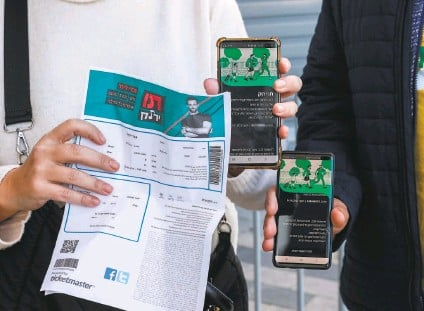 """?? Jack Guez / AFP / Getty Images ?? Israelis produce """"green passes,"""" proof of being vaccinated against COVID, to get into a concert in Tel Aviv last month."""