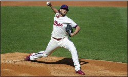 ?? LAURENCE KESTERSON – THE ASSOCIATED PRESS ?? Phillies' No. 1starter Aaron Nola, shown delivering a pitch against the Mets Wednesday at Citizens Bank Park, has pitched twice without getting a decision thus far this season.