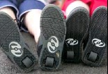 ??  ?? The shoe wheels are removable, but most wearers alternate between walking and gliding.