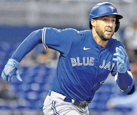 ?? USA TODAY SPORTS ?? Toronto Blue Jays outfielder George Springer runs out a ground ball for an out against the Miami Marlins in the second inning at loanDepot Park in Miami on Tuesday night.