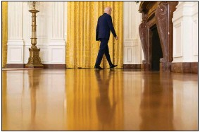?? (AP/Andrew Harnik) ?? President Joe Biden leaves a news conference on Russia sanctions Thursday in the East Room of the White House. In expelling 10 diplomats and imposing new sanctions, Biden signaled a harder line against Moscow.