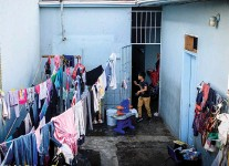 ?? EMILY KASK/NEW YORK TIMES ?? The Instituto Madre Asunta, a family shelter in Tijuana, Mexico, has been operating well above capacity after a Trump administration policy known as 'Remain in Mexico' went into effect this year.