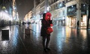 ?? LAURENT CIPRIANI AP ?? A woman walks down the street Jan. 16 at the start of the new curfew to counter COVID-19 in Lyon, France.