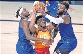 ?? THE ASSOCIATED PRESS ?? Utah guard DonovanMitchell has averaged more than 20 points in each of his three seasons. The Jazz rewarded their star youngster Sundaywith a max contract extension.