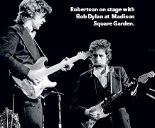 ??  ?? Robertson on stage with Bob Dylan at Madison Square Garden.