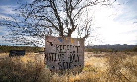 ?? Photograph: Sipa USA/Alamy ?? Signs posted at Oak Flat protest the possibility of the federal government clearing the way for a copper mine. Oak Flat sits atop one of the largest untapped copper deposits in the world, estimated to be worth more than $1bn.