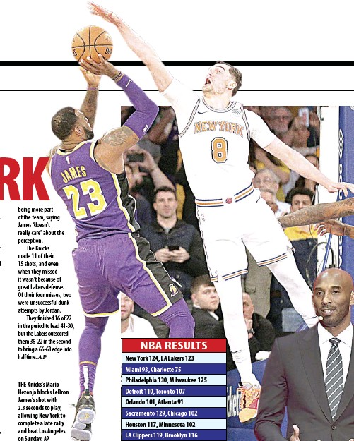 d24a44c60028 thE Knicks s Mario hezonja blocks LeBron James s shot with 2.3 seconds to  play