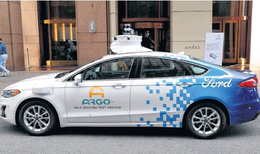 ?? REUTERS ?? An Argo Ai self driving prototype vehicle is seen outside a Ford and Volkswagen joint news conference in New York City.