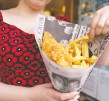 ?? LEON NEAL//AFP/GETTY ?? Meals such as traditional fish and chips, and other comfort foods, top travellers' wish lists as the coronavirus pandemic lockdown slowly eases across the United Kingdom.