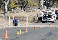 ??  ?? SEARCH: Detectives and forensic officers search for evidence in the murder of Pittsworth teen Robert Rowlingson.