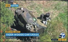 ?? AP ?? An aerial image shows the Tiger Woods crash scene. Woods had to be cut from the vehicle with 'Jaws of Life' rescue tools.