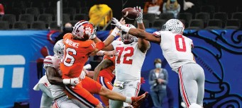?? GERALD HERBERT/AP ?? Clemson's Trevor Lawrence tries to pass during the second half against Ohio State in the Sugar Bowl on Friday at Mercedes-Benz Superdome in New Orleans.