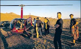 """??  ?? GUESTS WAIT to catch a helicopter ride. The one-night event is billed as a place where """"Burning Man and the Consumer Electronics Show collide."""""""