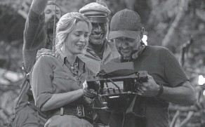 """?? PROVIDED BY FRANK MASI/ DISNEY ?? It's only acting. Emily Blunt, Dwayne Johnson check out their latest scene with director Jaume Collet- Serra on the set of """"Jungle Cruise."""""""