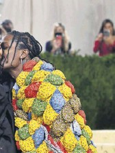 ?? PHOTOGRAPH: ANGELA WEISS/AFP/GETTY ?? ▲ Music stars Rihanna and A$AP Rocky wearing outfits designed by Balenciaga and Eli Russell Linnetz