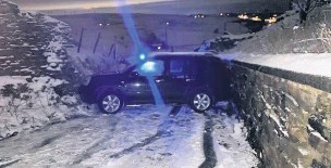 ?? Mick Gribben ?? ●● The access road to the Halo Haslingden was blocked by a car due to the dangerous wintry conditions.