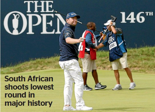 ?? PHOTO: REUTERS ?? Branden Grace completes his record-breaking round at Royal Birkdale yesterday, his 62 the lowest single round in a major championship.