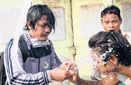 ?? AP ?? People rinse their faces after tear gas was used to disperse a protest Saturday in Mandalay, Myanmar. Security forces also used slingshots and rubber bullets against demonstrators.