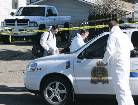 ?? FILES ?? Investigators had a gruesome scene on their hands on April 23, 2006 — a father, mother and their eight-year-old son brutally stabbed to death.