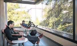 ?? Photographs by David Butow For The Times ?? THE REFASHIONED top two floors at UC Berkeley's Moffitt Library feature larger windows, transparent walls and higher ceilings with exposed vent ducts.