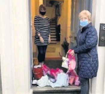 ??  ?? Bags of help Soroptimist International of Perth president Jean Black donating the items for clients of RASAC