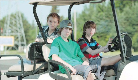 ?? AARON YEGER/ THE CANADIAN PRESS ?? Nate (Nick Serino), at the wheel, Riley (Reece Moffett), in the passenger seat, and Adam (Jackson Martin), star in Sleeping Giant, by Ontario-bred director Andrew Cividino. The teenage drama, a timeless love letter to adolescence, can already be...