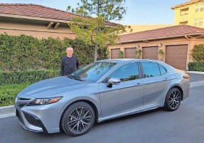 """?? P. ANN LU ?? Eric Young bought a 2021 Toyota Camry for about $27,000. """"Buying a used car for me is tough – if I knew the owner, that's a different story,"""" he says."""