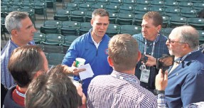 ?? CHARLES REX ARBOGAST, AP ?? Cubs president of baseball operations Theo Epstein, center, added Eric Hinske to the coaching staff, which has proved prescient.