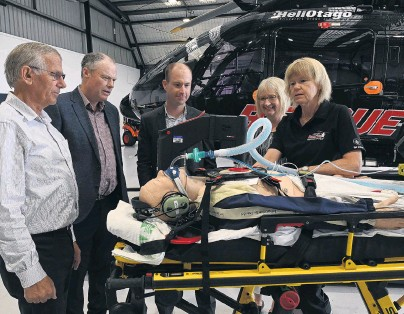 ?? PHOTO: LINDA ROBERTSON ?? Silver sponsors . . . After announcing a threeyear silver sponsorship agreement between Network Waitaki and the Otago Rescue Helicopter Trust, paramedic Monica Aarsen (far right) demonstrates emergency equipment to (from left) HeliOtago chief pilot Graeme Gale, Network Waitaki chairman Chris Dennison, Network Waitaki chief executive Geoff Douch and Otago Rescue Helicopter Trust secretary/manager Vivienne Seaton.