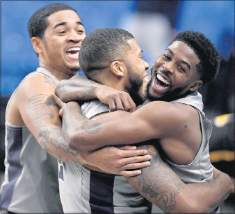 ?? THE ASSOCIATED PRESS ?? Penn State's Myles Dread is hugged by teammate Jamari Wheeler after his buzzer- beating 3-pointer for the home victory over VCU onWednesday night. The loss dropped the Rams' record to 2-2.