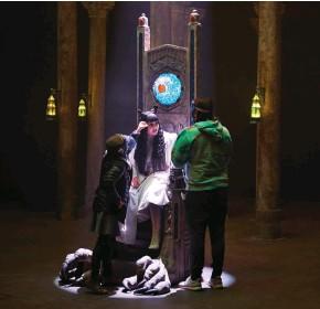 "??  ?? THE WALKING UNDEAD Above: Demetriou, center, gets touch-ups on the Toronto set. Left: Guillén (left) and Novak share a laugh. Below: Season Three guest star Kristen Schaal as a representative of the ""vampiric council."""