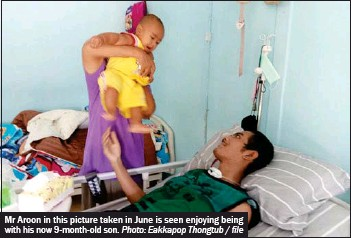 ?? Photo: Eakkapop Thongtub / file ?? Mr Aroon in this picture taken in June is seen enjoying being with his now 9-month-old son.