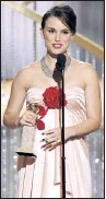?? By Paul Drinkwater, NBC ?? Big night: Portman wins the best-actress Globe for Black Swan. Her No Strings Attached arrives in theaters Friday.
