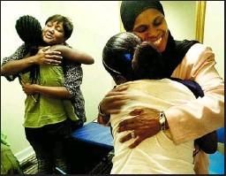 ??  ?? Munira Marlowe congratulated two Liberian refugees who got cosmetology scholarships from Hair-Lu-C-Nations in Fredericksburg, Va., last summer.