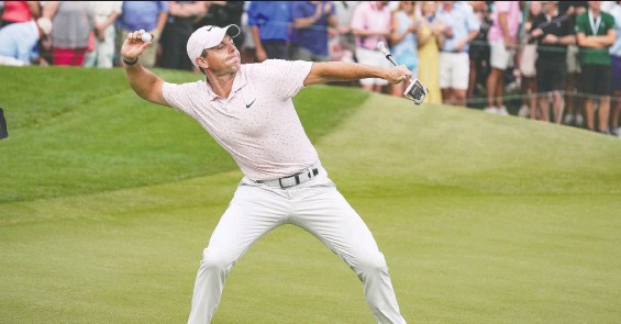 ?? JIM DEDMON-USA TODAY SPORTS ?? Rory McIlroy reacts by throwing his ball after clinching his third Wells Fargo championship at Quail Hollow Club in Charlotte, N.C., on Sunday.
