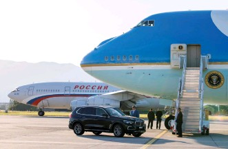 ?? (Reuters) ?? AIR FORCE ONE, the Boeing-747 airplane of US President Joe Biden, stands by yesterday as the Iljuschin Il-96, presumably carrying Russian President Vladimir Putin, taxies to the runway after the US-Russia summit, at Geneva Airport.